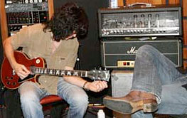 Tommy with his wine red Les Paul Deluxe.