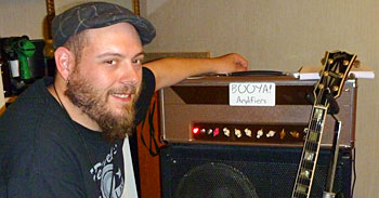 Booya! Amplifiers' Jamie Simpson about to get his ears whacked by my riffage!